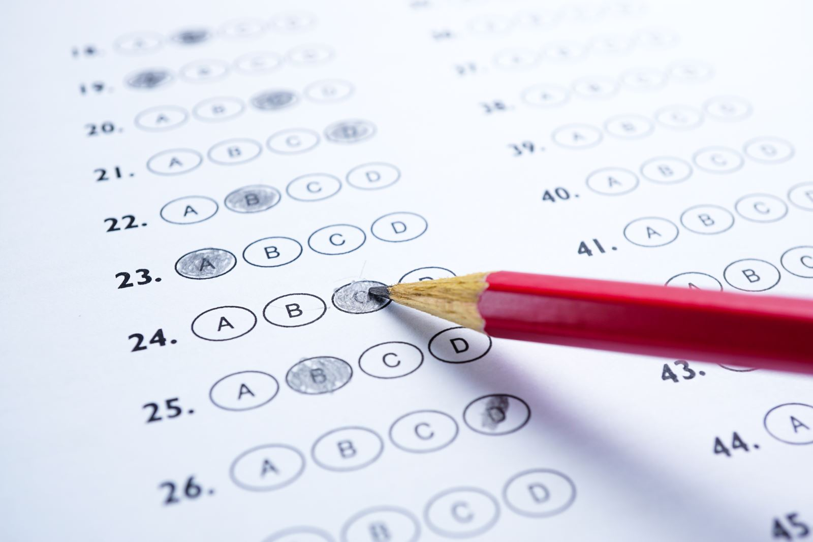 scantron test sheet with pencil filling in bubble